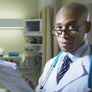 Doctor Filling out Medical Records