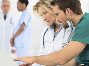 Doctors Working On Laptop