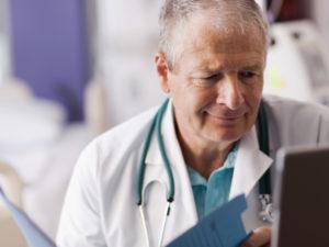 Locum tenens doctor looking at chart