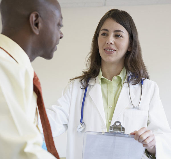 Doctor visiting with patient