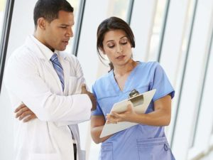 Doctor and nurse chatting