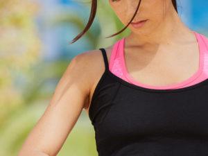 Jogger using fitness tracker