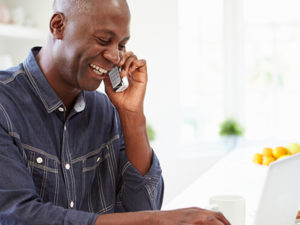 Man talking on the phone at home