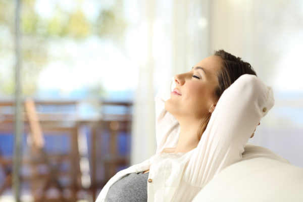 Weatherby Healthcare - malpractice insurance for locum tenens physicians - image of doctor relaxing after good news about her coverage