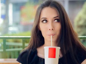 Woman drinking soda