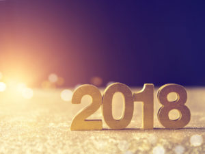 Weatherby Healthcare - new year resolutions for healthcare professionals - featured image of black and gold 2018 new year decoration