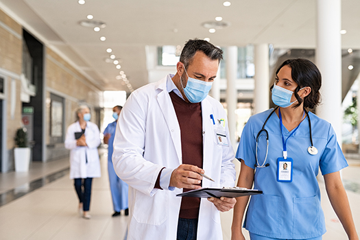 Physician and nurse consulting together