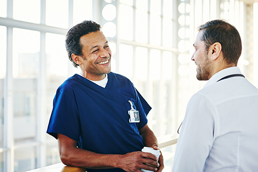 Medical professionals chatting during break