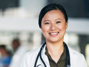 Woman physician smiling at camera