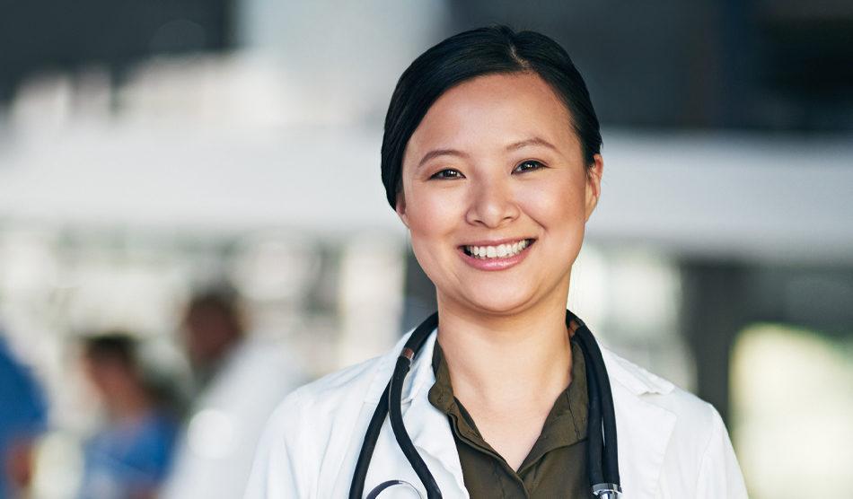 Woman physician smiling at camera