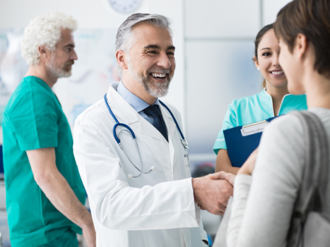 orthopaedic surgeon physician shaking hands with woman