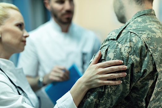 locum tenens military physician with hand on shoulder of military person