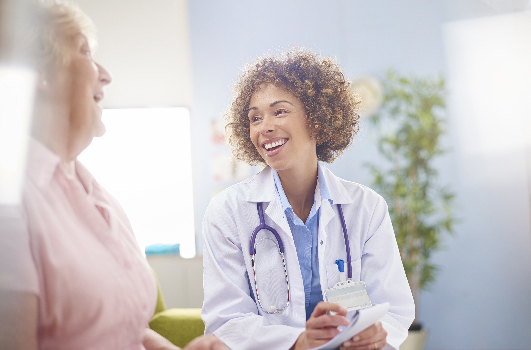 a female doctor with a senior woman