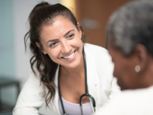 woman working as a locum tenens NP with a patient