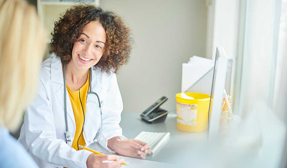 Friendly physician working to patient adherence to instructions