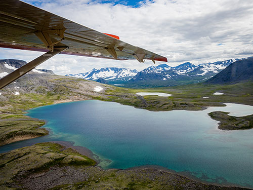 Bush plane flying over Alaska