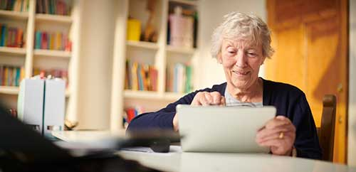 Elderly woman with an iPad