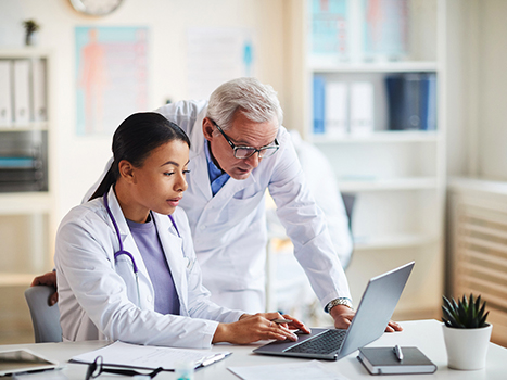 Physician collaborating with a colleague