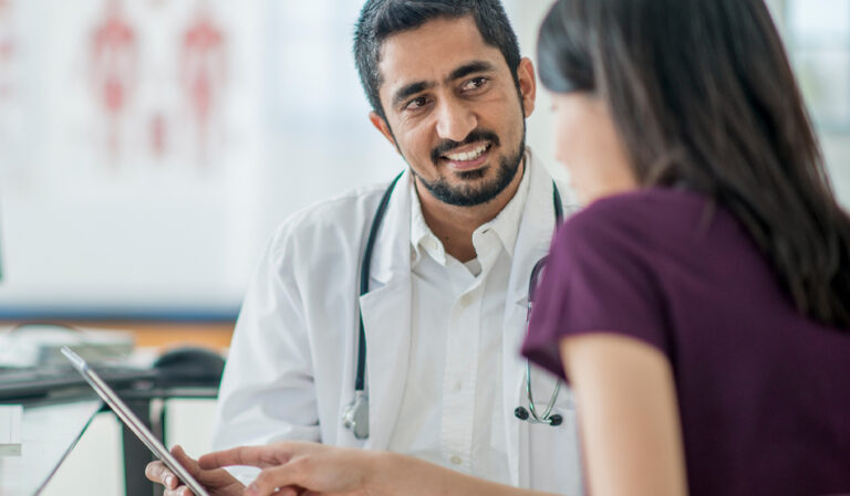 Physician explaining to a colleague why he chose to work locum tenens