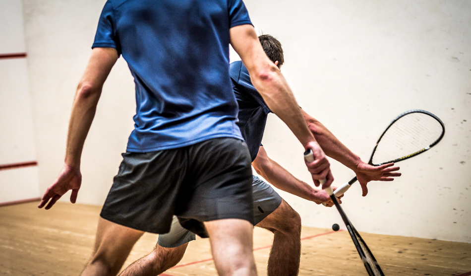 Physicians playing racketball and balancing personal life and their medical practice