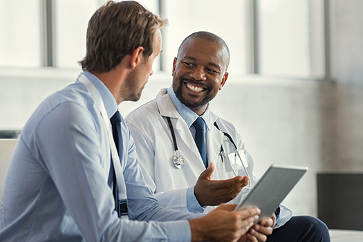 Physician being mentored by another physician